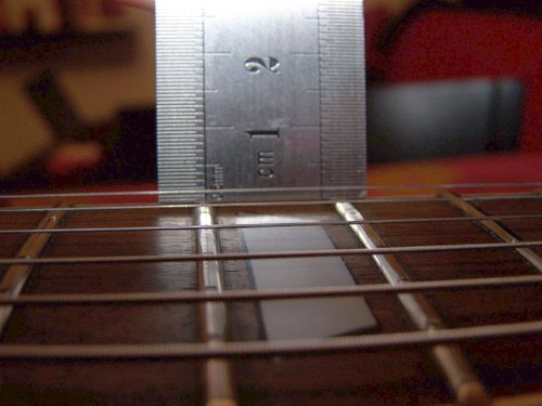 régler action guitare